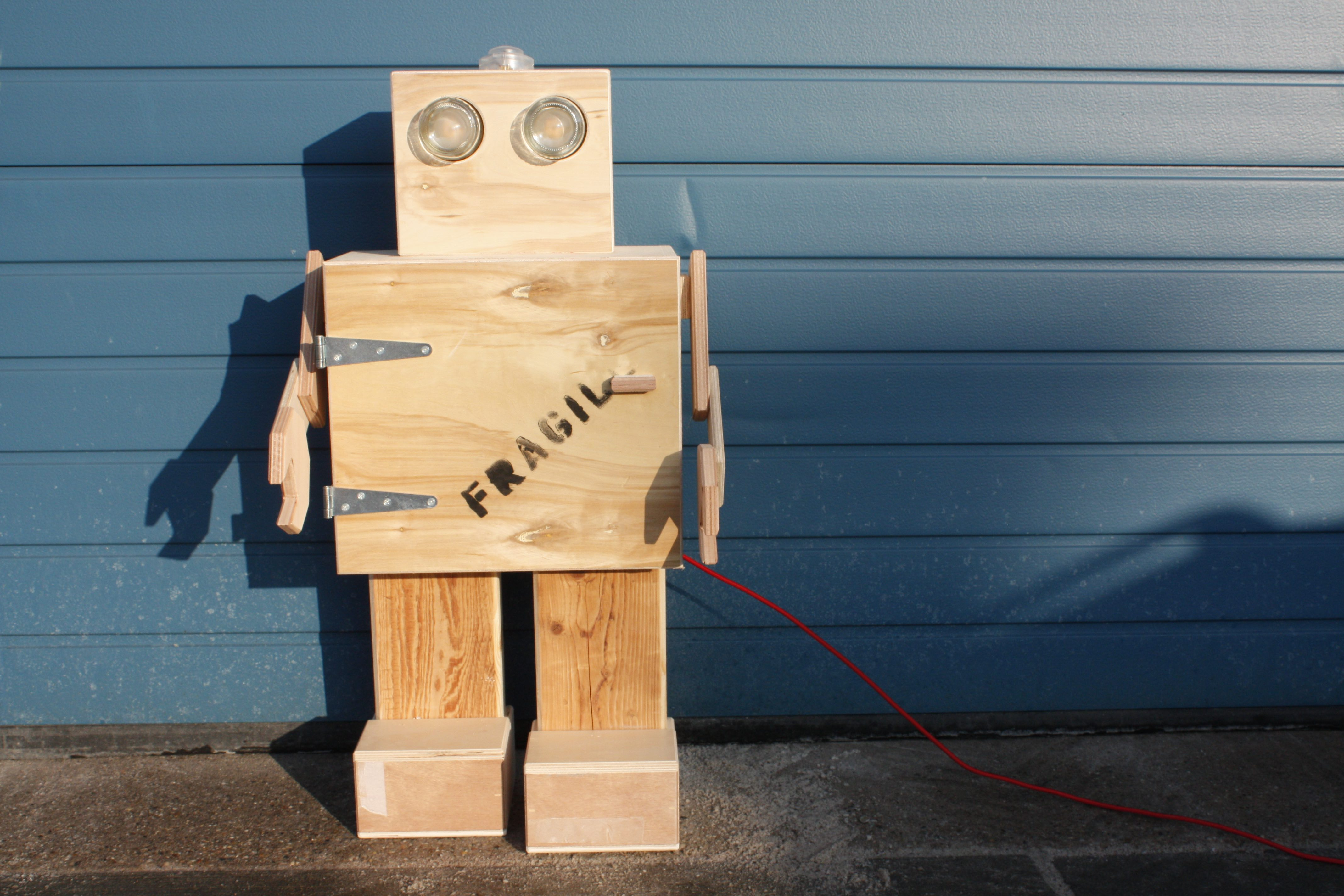 Rijkswachter - robot made from the wooden crates that used to protect precious artwork! Very smart upcycling.